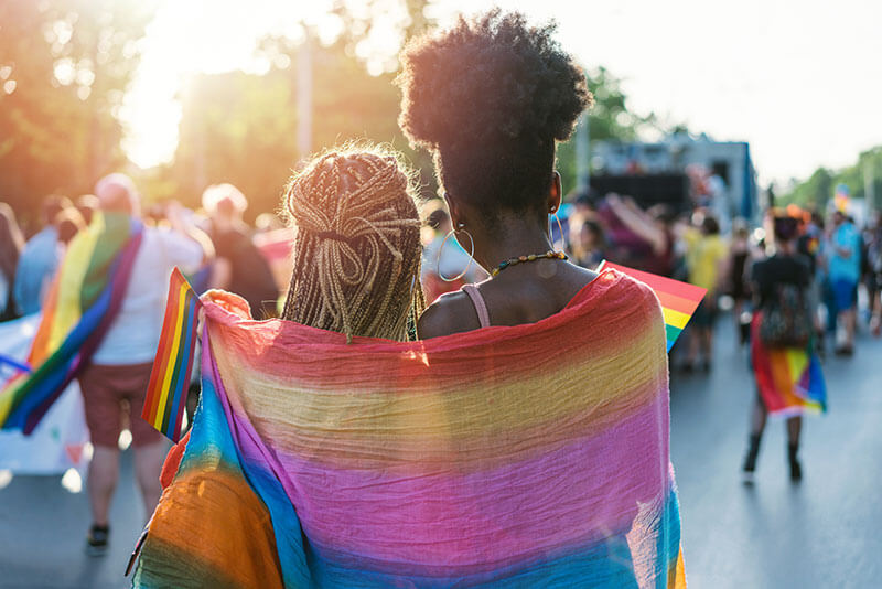 Women wrapped in pride flag